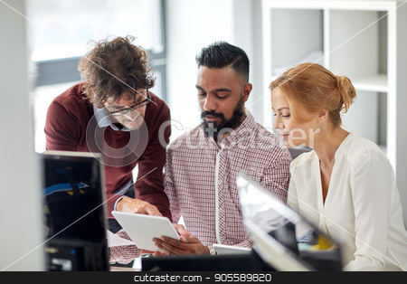 business team with tablet pc computers in office stock photo, business, startup and people concept - international creative team with tablet pc computers in office by Syda Productions