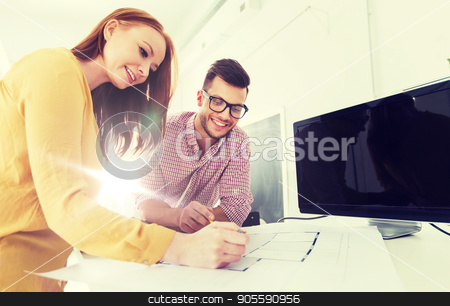 creative team with blueprint working at office stock photo, business, startup, architecture and people concept - happy creative architect team or students with blueprint and computer working at office by Syda Productions