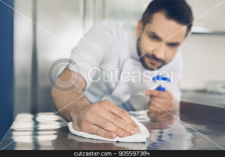 Man japanese restaurant chef working in the kitchen stock photo, Male japanese restaurant chef working in the kitchen cleaning by Dmytro Sidelnikov