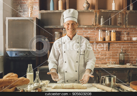 Bakery chef cooking bake in the kitchen professional stock photo, Bakery chef cooking bake in the kitchen professional making roll by Dmytro Sidelnikov