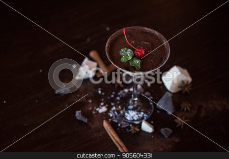 dessert from different kind of chocolate stock photo, dessert from different kind of chocolate decorated with cherry on dark brown background by olinchuk