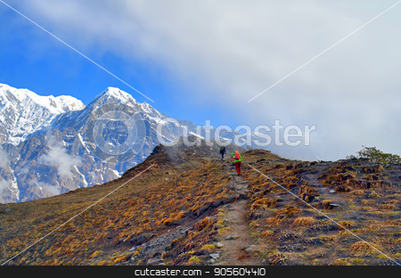 Pair of travelers and cloud in Himalaya. Mountain Landscape. stock photo, Pair of travelers and cloud in Himalaya. Mountain Landscape. Annapurna region, Nepal, Mardi Himal track. by verock