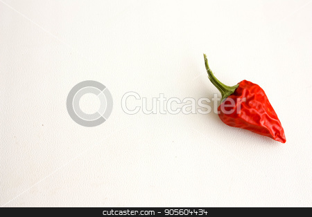 Red pepper on a white background stock photo, Red pepper on a white background with a green tail. Photo for your design by Kseniia