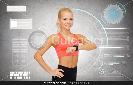 happy sporty young woman with fitness tracker stock photo, sport, fitness and technology concept - happy smiling young woman with heart-rate tracker or smartwatch over gray concrete background by Syda Productions