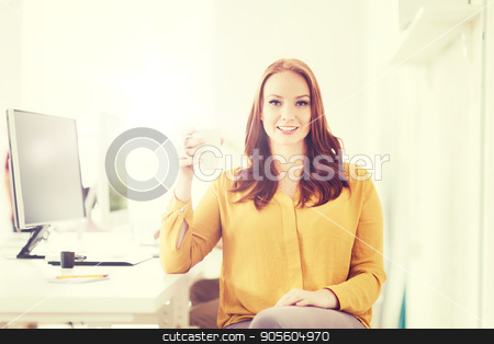 happy woman drinking coffee or tea at office stock photo, business, startup, people and break concept - happy businesswoman drinking coffee or tea at office by Syda Productions