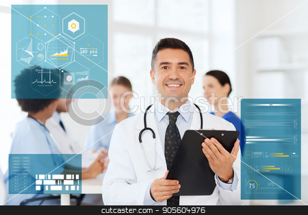 happy doctor with clipboard over medical team stock photo, clinic, profession, people and medicine concept - happy male doctor with clipboard over group of medics meeting at hospital by Syda Productions