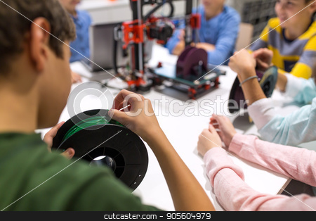 children with 3d printer at robotics school stock photo, education, children, technology, science and people concept - group of kids with 3d printer and filament spool at robotics school lesson by Syda Productions