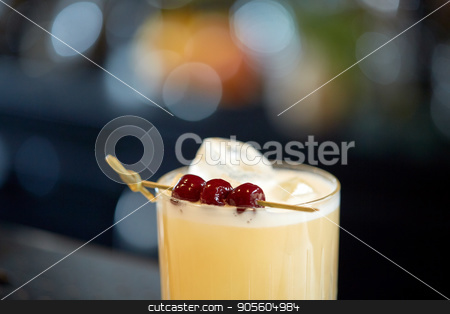 close up of cocktail glass with cherries at bar stock photo, alcohol drinks and luxury concept - close up of cocktail glass with cherries at bar by Syda Productions
