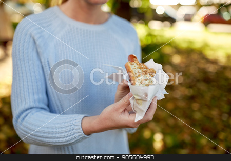 close up of woman with hot dog stock photo, fast food, people and unhealthy eating concept - close up of woman with hot dog by Syda Productions