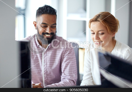 happy business team working at office stock photo, business, teamwork and people concept - happy international creative team working at office by Syda Productions