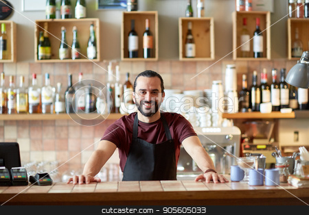happy man, barman or waiter at bar stock photo, small business, people and service concept - happy man or waiter in apron at bar or coffee shop by Syda Productions