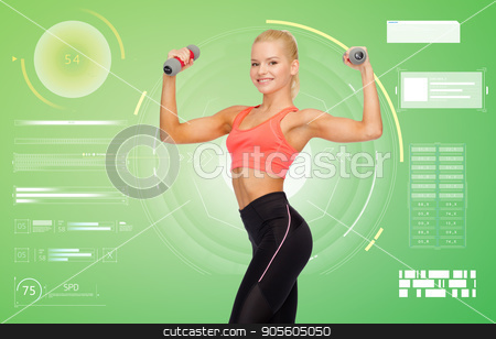 happy young sporty woman exercising with dumbbells stock photo, sport, fitness and people concept - happy smiling young sporty woman exercising with light dumbbells over green background by Syda Productions
