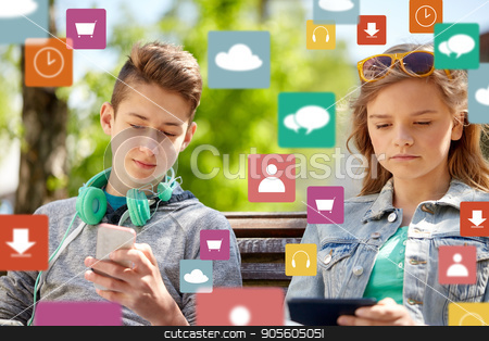 teenage friends with gadgets outdoors stock photo, technology, internet and people concept - teenage boy with smartphone and headphones and girl with tablet pc computer outdoors over virtual icons by Syda Productions