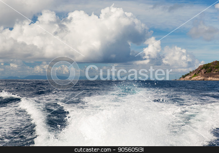 indian ocean and leaving boat trace on water stock photo, travel, seascape and nature concept - sea or indian ocean and trace on water of boat leaving seychelles by Syda Productions