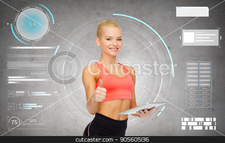 sporty woman with tablet pc showing thumbs up stock photo, sport, fitness and technology - happy sporty woman with tablet pc computer showing thumbs up over gray concrete background by Syda Productions