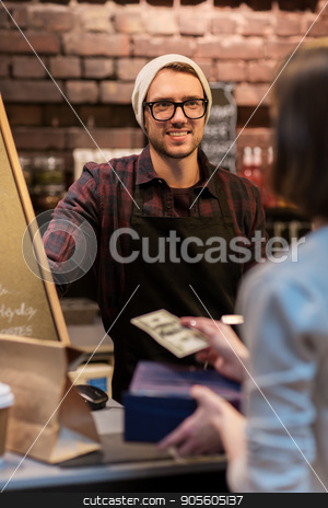 happy barman and woman paying money at cafe stock photo, small business, payment, people and service concept - happy barman and woman paying money at cafe by Syda Productions
