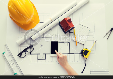 close up of hand with blueprint and smartphone stock photo, business, architecture, building, construction and people concept - close up of architect hand with living house blueprint and smarphone by Syda Productions
