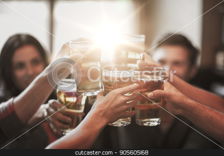 happy friends drinking beer at bar or pub stock photo, people, leisure, friendship and celebration concept - happy friends drinking draft beer and clinking glasses at bar or pub by Syda Productions