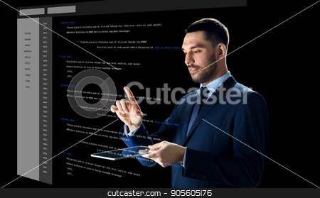 businessman with tablet pc and virtual coding stock photo, business, people and future technology concept - businessman in suit working with transparent tablet pc computer and coding on virtual screen over black background by Syda Productions