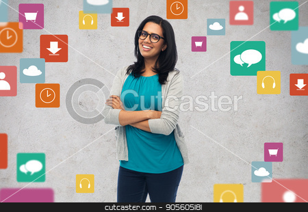 happy smiling young indian woman in glasses stock photo, people, multimedia and technology concept - happy smiling young indian woman in glasses by Syda Productions