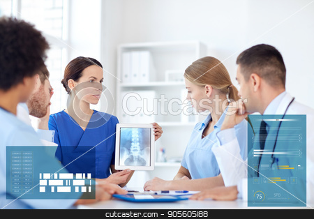 group of doctors with x-ray on tablet pc at clinic stock photo, profession, people, surgery, radiology and medicine concept - group of doctors with x-ray on tablet pc computer screen meeting at medical office by Syda Productions
