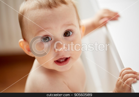 happy little baby boy or girl at home stock photo, childhood, babyhood, emotions and people concept - close up of happy little baby boy or girl at home by Syda Productions