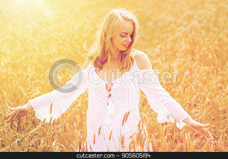 smiling young woman in white dress on cereal field stock photo, country, nature, summer holidays, vacation and people concept - smiling young woman in white dress on cereal field by Syda Productions