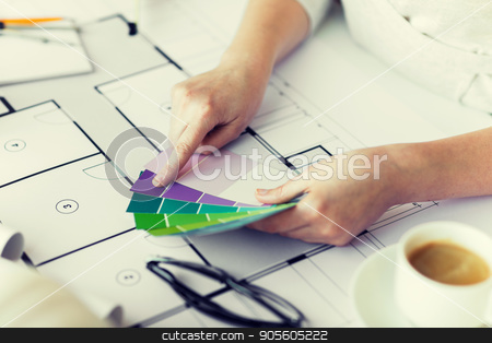 close up of hands with color palette and blueprint stock photo, business, architecture, building, construction and people concept - close up of designer hands with color palette and blueprint by Syda Productions