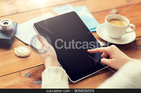 close up of traveler hands with tablet pc and map stock photo, vacation, tourism, travel, technology and people concept - close up of traveler hands with blank tablet pc computer and map by Syda Productions