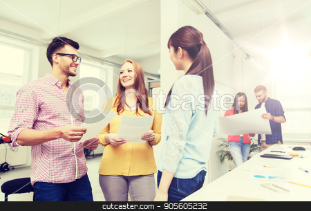 creative team on coffee break talking at office stock photo, business, communication, startup and people concept - happy multiracial creative team or students on coffee break talking at office by Syda Productions