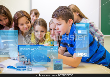 group of kids with teacher and tablet pc at school stock photo, education, elementary school, learning, technology and people concept - group of kids with teacher looking to tablet pc computer in classroom and virtual screen projection by Syda Productions