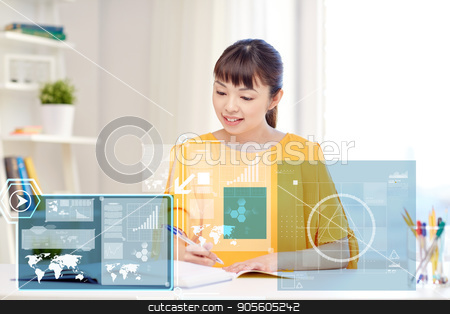 happy asian young woman student learning at home stock photo, people, education and high school concept - happy asian young woman student with book and notepad writing at home by Syda Productions