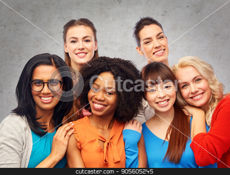 international group of happy women hugging stock photo, diversity, ethnicity and people concept - international group of happy smiling different women hugging over gray concrete wall background by Syda Productions