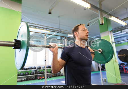 man doing exercise with barbell in gym stock photo, sport, fitness and people concept - smiling man doing exercise with barbell in gym by Syda Productions