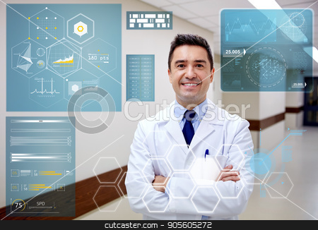 smiling doctor at hospital corridor stock photo, people, healthcare and medicine concept - smiling doctor at hospital corridor by Syda Productions