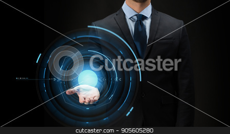 businessman with virtual projection over black stock photo, business, future technology, cyberspace and people - close up of businessman with virtual projection over black background by Syda Productions