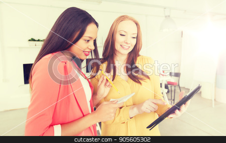creative team with table pc in office stock photo, business, office, technology and startup concept - happy creative team with table pc in office by Syda Productions