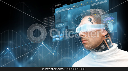 man in virtual reality glasses and microchip stock photo, augmented reality, technology, business, future and people concept - man in virtual glasses and microchip implant or sensors looking at screen projections with diagram charts over dark background by Syda Productions