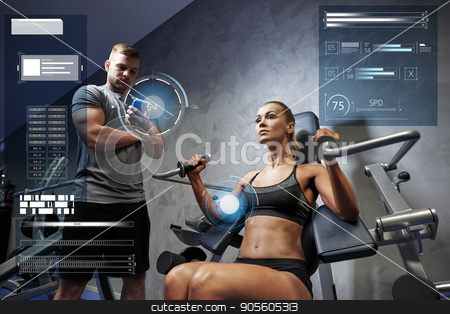 man and woman flexing muscles on gym machine stock photo, sport, fitness, bodybuilding, exercising and people concept - young woman and personal trainer with smartphone flexing muscles on gym machine over virtual charts by Syda Productions