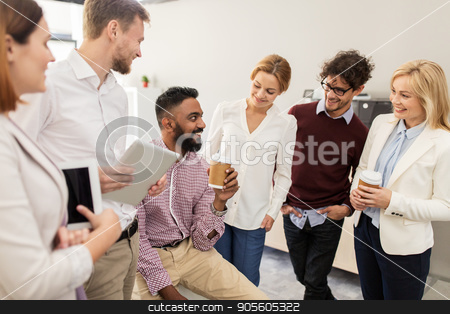 happy business team drinking coffee at office stock photo, business, break, communication and people concept - happy creative team drinking coffee and talking at office by Syda Productions