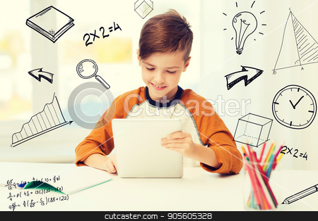 smiling boy with tablet pc and notebook at home stock photo, leisure, children, education, technology and people concept - smiling boy with tablet pc computer and notebook at home over mathematical doodles by Syda Productions