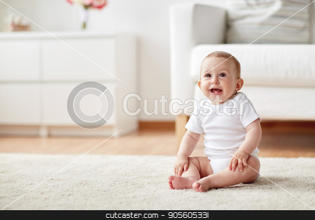 happy baby boy or girl sitting on floor at home stock photo, childhood, babyhood and people concept - happy little baby boy or girl sitting on floor at home by Syda Productions