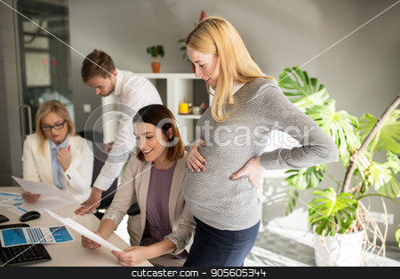 happy business team with papers in office stock photo, pregnancy and people concept - happy business team with papers in office by Syda Productions