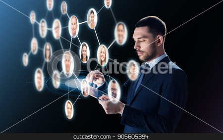 businessman with tablet pc and contacts network stock photo, business, people, headhunting, communication and modern technology concept - businessman in suit working with transparent tablet pc computer and contacts network over black background by Syda Productions