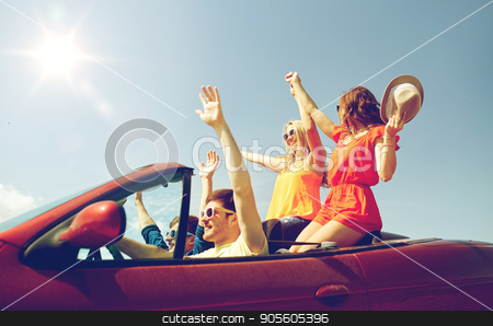 happy friends driving in cabriolet car at country stock photo, leisure, road trip, travel and people concept - happy friends driving in cabriolet car at country and waving hands by Syda Productions