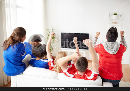 friends or football fans watching tv at home stock photo, friendship, leisure, sport, people and entertainment concept - happy friends or football fans watching soccer on tv and celebrating victory at home by Syda Productions