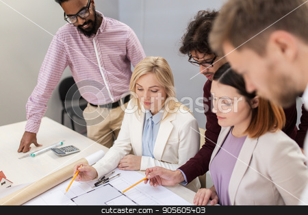 business team discussing house project at office stock photo, building, construction, architecture, real estate and people concept - business team with blueprint meeting and discussing house project at office by Syda Productions