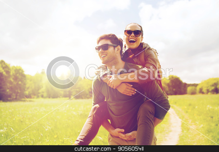 happy couple with backpacks having fun outdoors stock photo, travel, hiking, backpacking, tourism and people concept - happy couple with backpacks having fun and walking along country road outdoors by Syda Productions