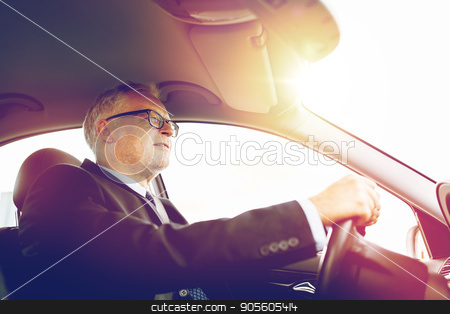 happy senior businessman driving car stock photo, transport, business trip and people concept - happy senior businessman driving car by Syda Productions