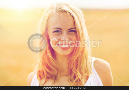 smiling young woman in white on cereal field stock photo, country, nature, summer holidays, vacation and people concept - smiling young woman in white on cereal field by Syda Productions